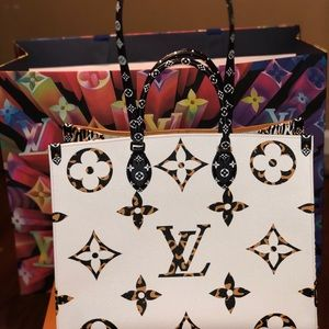 Authentic Louis Vuitton OnTheGo Jungle ivory